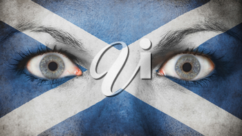 Close up of eyes. Painted face with flag of Scotland