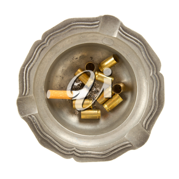 Empty 9mm bullet casings in an old tin ashtray, isolated