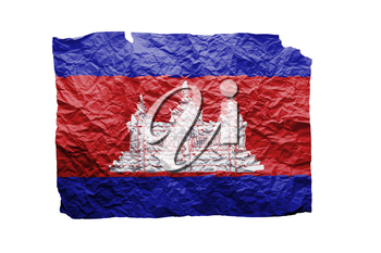 Close up of a curled paper on white background, print of the flag of Cambodia