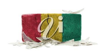 Brick with broken glass, violence concept, flag of Guinea