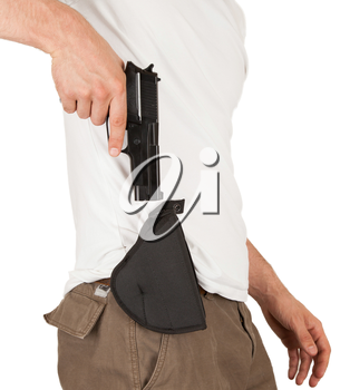 Close-up of a man with holster and a gun, isolated on white