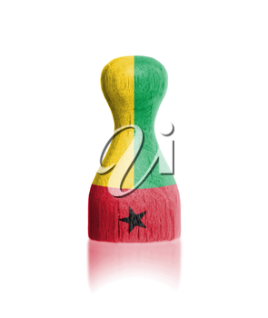 Wooden pawn with a painting of a flag, Guinea-Bissau