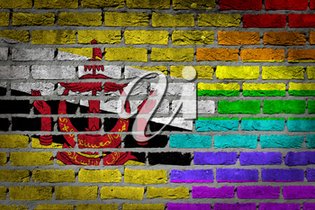 Dark brick wall texture - coutry flag and rainbow flag painted on wall - Brunei
