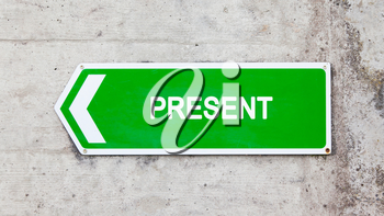 Green sign on a concrete wall - Present