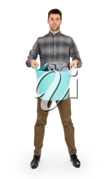 Full length portrait of a young man holding a laundry basket isolated on white background