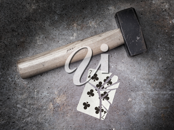 Hammer with a broken card, vintage look, seven of clubs