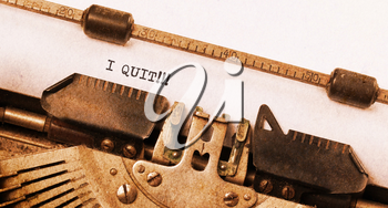 Vintage typewriter close-up - I Quit, concept of quitting