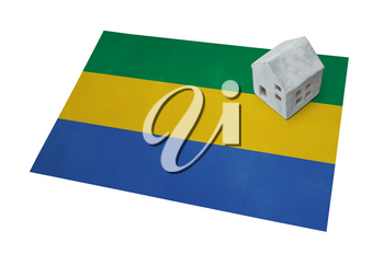Small house on a flag - Living or migrating to Gabon