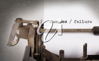 Vintage typewriter, old rusty, warm yellow filter - Success or failure