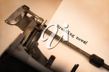Vintage inscription made by old typewriter, breaking news