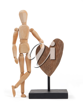 Wooden mannequin with a big heart - isolated on white background