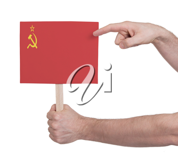 Hand holding small card, isolated on white - Flag of the USSR