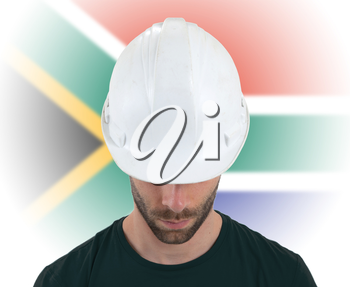 Isolated engineer with flag on background - South Africa