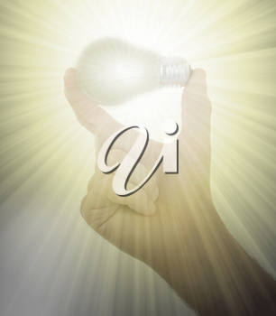 Hand holding an light bulb isolated on white background