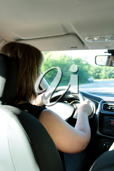 image of young woman driving the car
