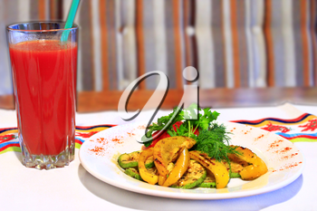 dish for vegetarians vegetables grilled paprica tomatoes zucchini fennel and glass of tomato juice