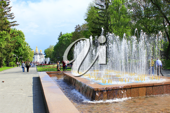 People have a rest in city park with fountains in the spring