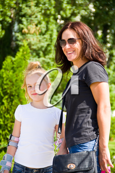Photo of smiling mother and daughter in summer
