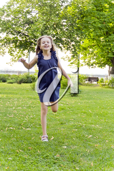 Girl is running in park on green grass