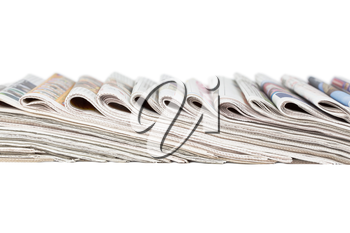 Assortment of folded newspapers isolated on white