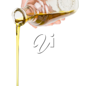 Male hand holding a bottle. Oil pouring from a bottle.