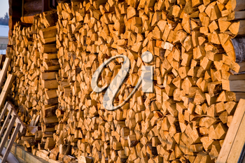 stack of firewood in village in winter