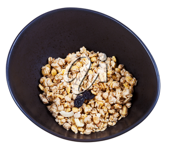dried muesli with raisin and nuts in black bowl