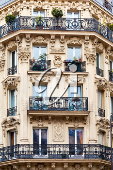 corner of of typical house with balcony in Paris, France
