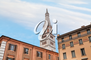 torre della ghirlandina - bell tower of Modena Cathedral under urban houses, Italy