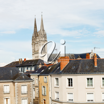 view of urban houses and Saint Maurice Cathedral in Angers, France