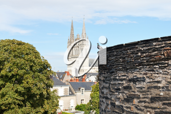 Castle wall and Saint Maurice Cathedral in Angers city, France