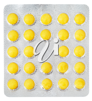yellow pills in blister pack isolated on white background