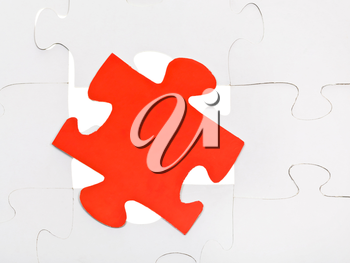 red puzzle piece on free space in layer assembled puzzles