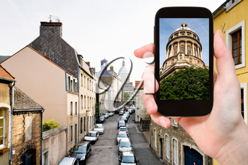 travel concept - tourist taking photo of Cathedral in Boulogne-Sur-Mer on mobile gadget, France