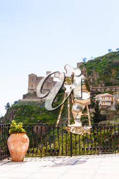 SAVOCA, ITALY - APRIL 4, 2015: Statue of Francis Ford Coppola created by Nino Ucchino - a local artist. The town Savoca was location for scenes set in Corleone of Francis Ford Coppola's The Godfather.