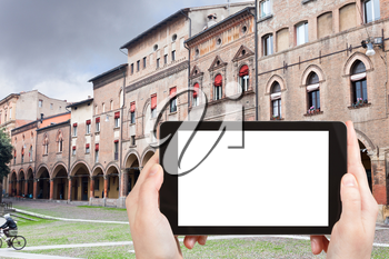 travel concept - tourist photograph Piazza Santo Stefano in autumn day in Bologna, Italy on tablet pc with cut out screen with blank place for advertising logo