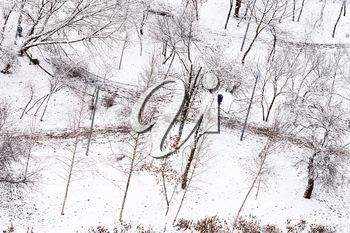 above view of footpath in snow urban park in winter season
