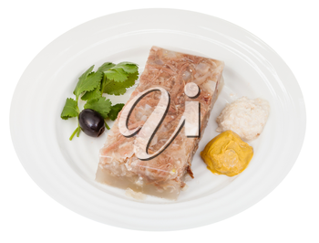 portion of beef aspic with seasonings on white plate isolated on white background