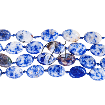 four strings of beads from blue lapis lazuli gem stone isolated on white background