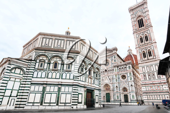 travel to Italy - view of Florence Baptistery (Battistero di San Giovanni, Baptistery of Saint John) and Duomo Cathedral Santa Maria del Fiore with Giotto's Campanile on Piazza San Giovanni in morning