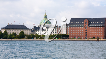 Travel to Denmark - waterfront with edifice of The Royal Cast Collection at the West India Warehouse and view of dome of Marble Church (Frederik's Church, Marmorkirken) in Copenhagen city in autumn