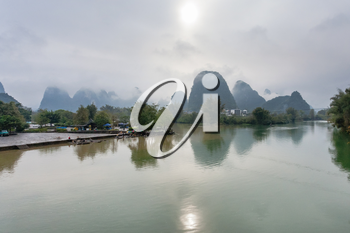 travel to China - panormic view of Yulong and Jinbao rivers and karst peaks in Yangshuo County in spring season