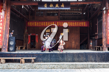 CHENGYANG, CHINA - MARCH 27, 2017: dong people in Culture Show on square of Folk Custom Centre of Chengyang village of Sanjiang County in spring. Chengyang includes eight villages of the Dong people