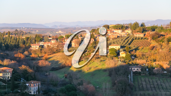 travel to Italy - country houses and gardens in Siena city on hills in winter evening