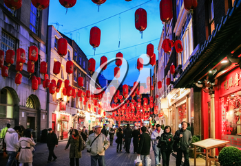 LONDON, UK - JANUARY 20, 2009: visitors in China Town decorated by Chinese lanterns during Chinese New Year in London. First organized Chinese New Year celebrations in the Chinatown took place in 1985