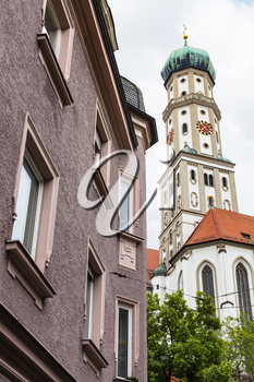 Travel to Germany - towers of SS Ulrich and Afra Church and urban house in Augsburg city in cloudy spring day