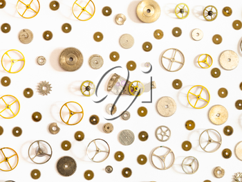 watchmaker workshop - pattern from various used watch spare parts on white background