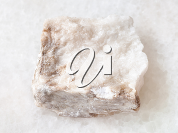 macro shooting of natural mineral rock specimen - rough Anhydrite stone on white marble background