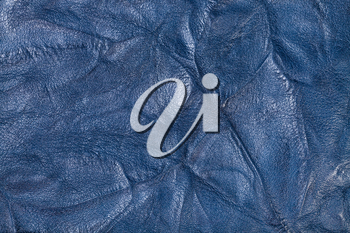 textured background from blue crumpled leather close up