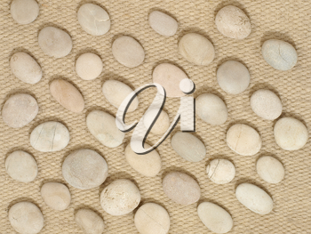 Stones on a wool fabric as background.